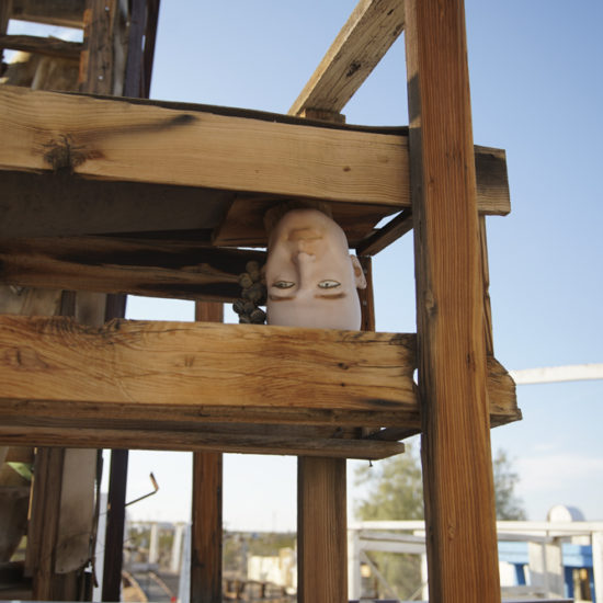 Sculpture of wood structure with mannequin head