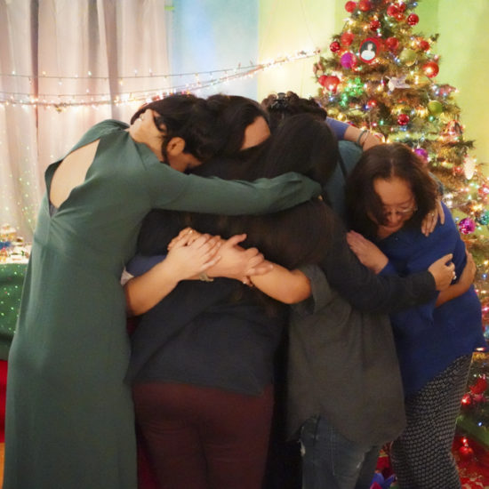 Group of women of chicana familia hugging