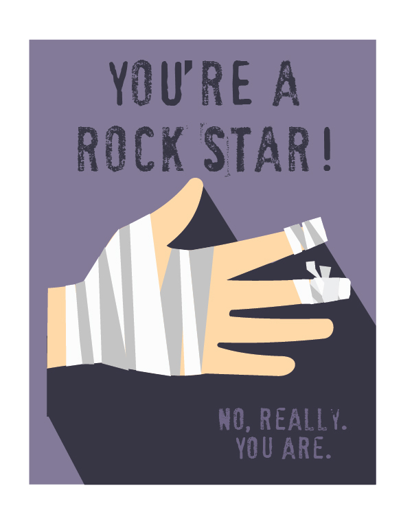 Note card that says 'You're a rock star. No really. You Are' with a bandaged hand.